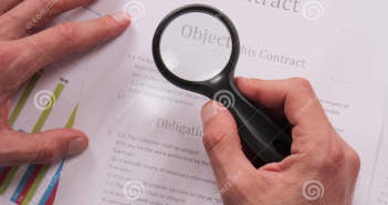 http://www.dreamstime.com/royalty-free-stock-images-close-up-businessman-using-loupe-reading-contract-magnifying-glass-document-lawyer-minutely-checking-documents-image64449809