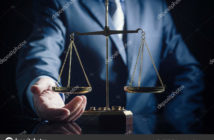 Weight scale of justice, lawyer in background. justice law lawyer attorney scale weight court authority concept
